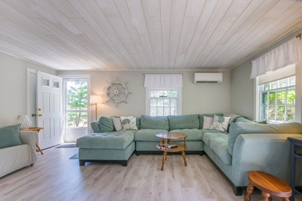 East Sandwich Cape Cod vacation rental - Main entry into Living area with comfy seating and AC wall unit.