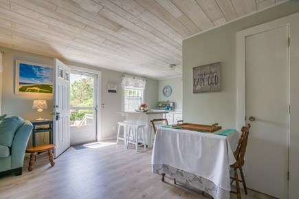 East Sandwich Cape Cod vacation rental - Living area opens into Kitchen, with door to back yard.