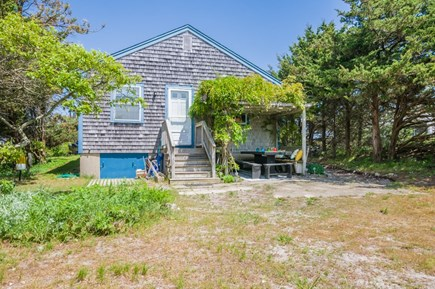 East Sandwich Cape Cod vacation rental - Back of house with steps down to covered dining area