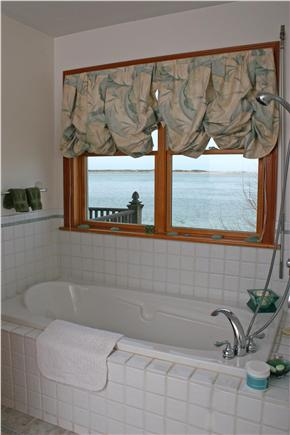 Barnstable Cape Cod vacation rental - Master bedroom Jacuzzi with light house views.