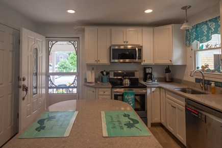 Truro Cape Cod vacation rental - Kitchen opens to farmer's porch. Slider opens to large deck area.