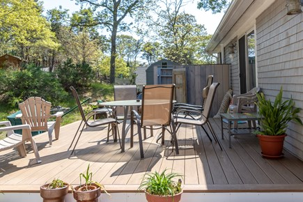 Truro Cape Cod vacation rental - The kitchen has a slider that opens to deck in the backyard.