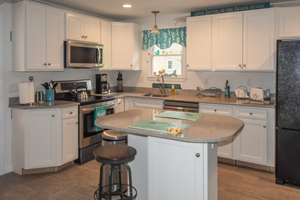 Truro Cape Cod vacation rental - Beautiful cabinets w/quart countertops.