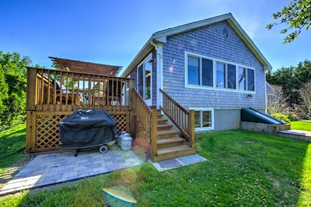 Sandwich Cape Cod vacation rental - Back of cottage with private yard, patio and gas grill.