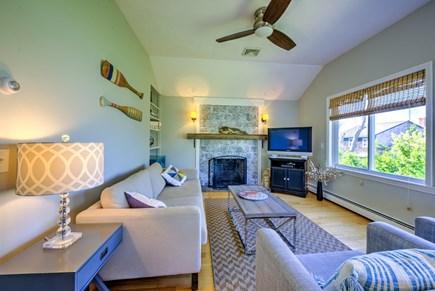 Sandwich Cape Cod vacation rental - Fireplace and TV in Living Room with views of Cape Cod Bay.