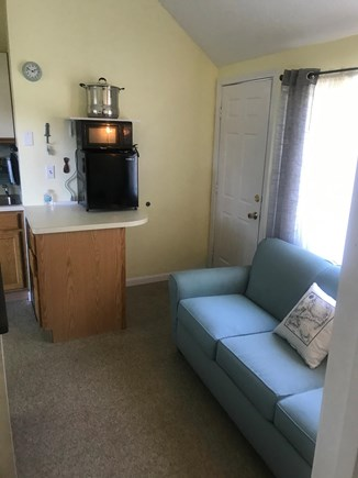 Harwich Port Cape Cod vacation rental - Sofa and kitchen area