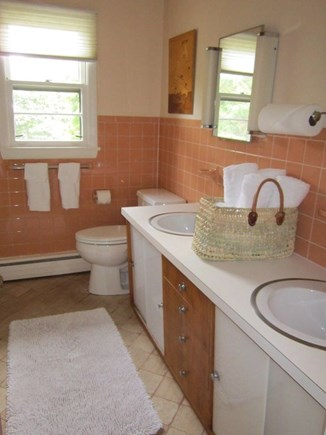 East Orleans Cape Cod vacation rental - Main bathroom with two sinks, bathtub and shower to left