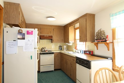 Dennis Port Cape Cod vacation rental - Cute galley kitchen overlooking the backyard