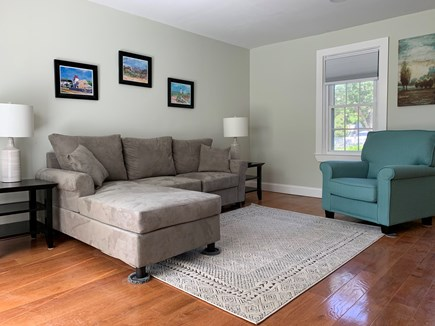 Centerville Centerville vacation rental - Living room with slider to back deck with marsh views.