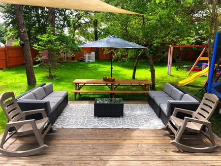 Dennisport Cape Cod vacation rental - Back yard with deck, lounge area, picnic table and more...