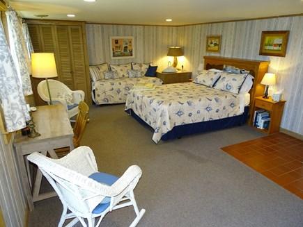 Wellfleet Cape Cod vacation rental - Lower level queen bedroom w/ adjacent bath, slider to back patio