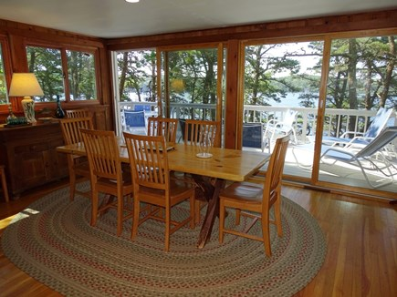 Wellfleet Cape Cod vacation rental - Dining area adjacent to sliders to deck, water views