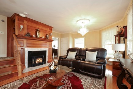 Falmouth Cape Cod vacation rental - Inviting living room with TV and fireplace