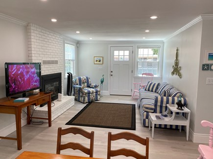 Brewster Cape Cod vacation rental - Living area with TV, fireplace and seating