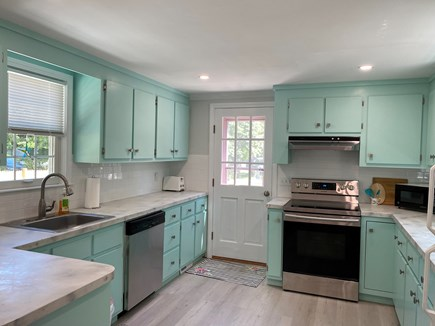 Brewster Cape Cod vacation rental - Kitchen with new dishwasher and stove/oven