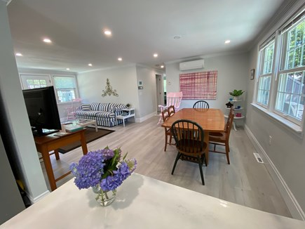 Brewster Cape Cod vacation rental - Dining table w seating for 6 & family room with TV and fireplace