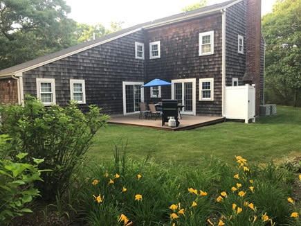 Brewster Cape Cod vacation rental - Private back yard with patio deck and outdoor shower.