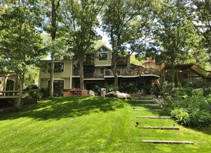 Mashpee Cape Cod vacation rental - Spacious backyard. Apt. is above the detached garage on the right