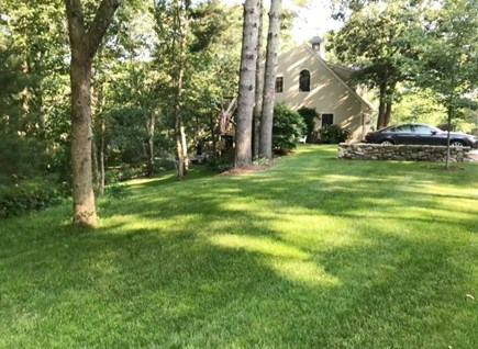 Mashpee Cape Cod vacation rental - Side yard and guest parking