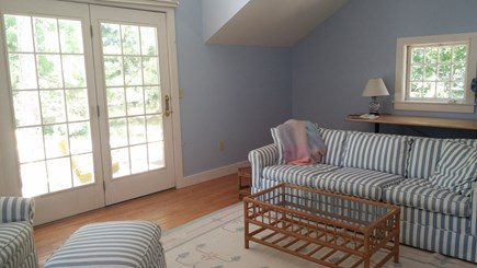 Harwich Cape Cod vacation rental - Gracious family room facing side deck