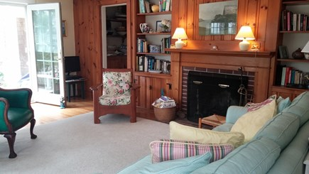 Harwich Cape Cod vacation rental - Living room opens to side patio with breeze from the golf course