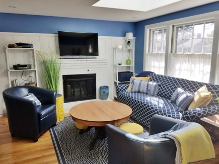 Dennis, Miramar Beach House Cape Cod vacation rental - Living room area with TV, extra stool seating