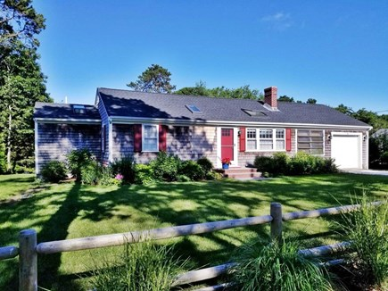 Dennis, Miramar Beach House Cape Cod vacation rental - Front of house, fenced and grassed yard, parking for 3 cars