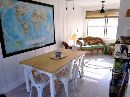 Dennis, Miramar Beach House Cape Cod vacation rental - Breezeway off kitchen, dining table with fan, extra seating area