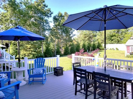 Dennis, Miramar Beach House Cape Cod vacation rental - Back deck with dining, gas grill, enclosed shower, adirondacks