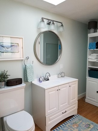 Dennis, Miramar Beach House Cape Cod vacation rental - Master bath shelf storage, shower and full washer and dryer