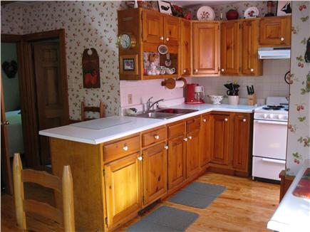 North Eastham Cape Cod vacation rental - View of Kitchen with a Strawberry Theme, even the Dinnerware
