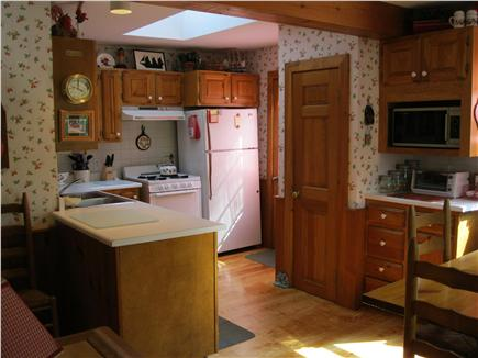 North Eastham Cape Cod vacation rental - View of fully stocked kitchen with skylight, and pine floors