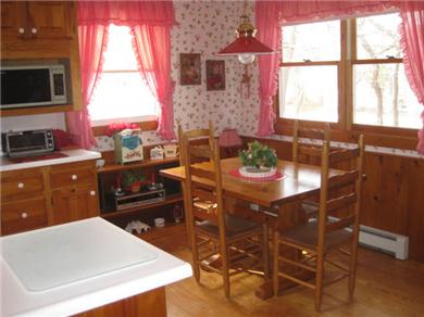 North Eastham Cape Cod vacation rental - Dining area with table that will sit 6 people