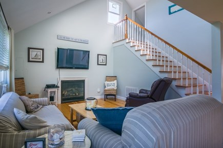 Sandwich Cape Cod vacation rental - Living area with TV, Fireplace and window AC unit.