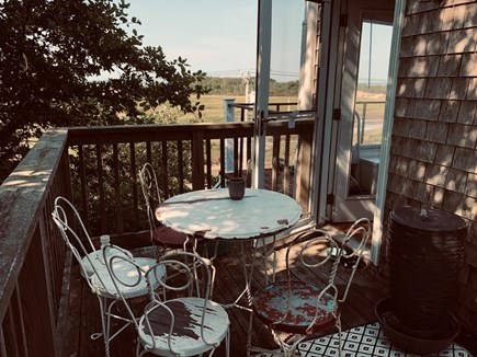 Truro Cape Cod vacation rental - East deck with fountain and shade
