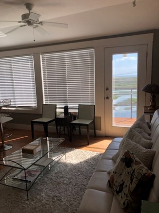 Truro Cape Cod vacation rental - Living room, south deck beyond