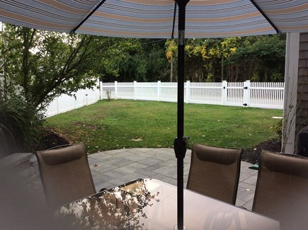 Pocasset, Wenaumet Bluffs Cape Cod vacation rental - Back patio and side fenced in yard