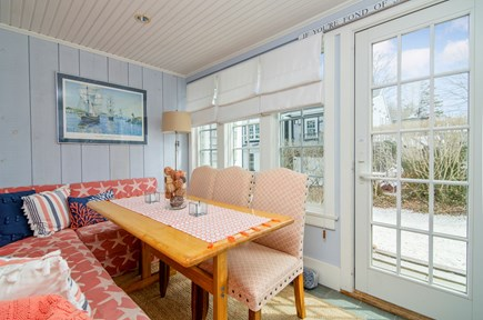 Chatham Cape Cod vacation rental - Guests can enjoy meals in this cozy sun-filled porch.