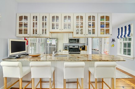 Chatham Cape Cod vacation rental - Bright kitchen w/seating for eight at granite bar and cafe table.