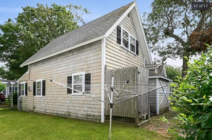 Harwich Port Cape Cod vacation rental - View of back of cottage including outdoor shower.