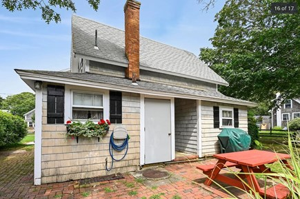 Harwich Port Cape Cod vacation rental - View of the side yard with grill and outdoor seating.