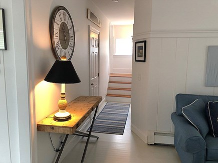 Harwichport Cape Cod vacation rental - Hallway to First Floor Bath, Laundry and Stairway to Second Floor