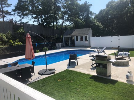 Bourne Cape Cod vacation rental - Beautiful Back yard with a huge pool and a fire pit.