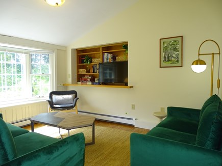 East Falmouth Waterfront Cape Cod vacation rental - TV room with comfortable couches and bay window facing water