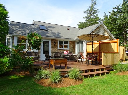 East Falmouth Waterfront Cape Cod vacation rental - Lovely deck area looks out over yard and water views