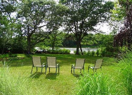 East Falmouth Waterfront Cape Cod vacation rental - Back yard leads to dock