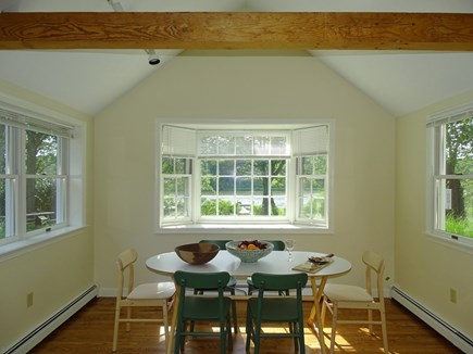 East Falmouth Waterfront Cape Cod vacation rental - Dining area with bay window facing yard and water views