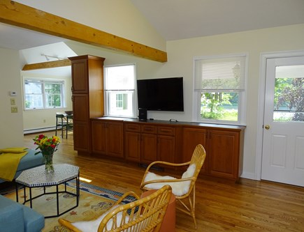 East Falmouth Waterfront Cape Cod vacation rental - Living room with TV, door to back yard, water views