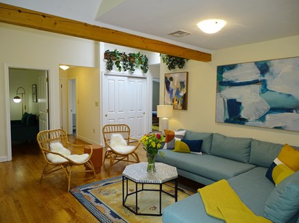 East Falmouth Waterfront Cape Cod vacation rental - Living room leads to TV room, half bath, bedrooms