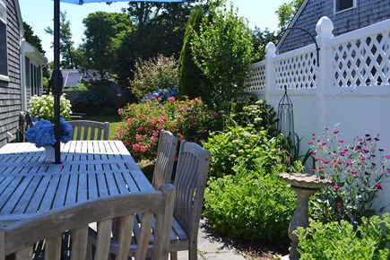 Falmouth Cape Cod vacation rental - Outdoor dining table in the garden